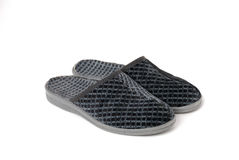 Two slippers on a white. Two grey slippers isolated on white Royalty Free Stock Photos