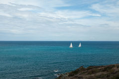 Two Sailboats Racing in the Caribbean Stock Images