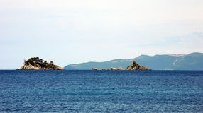 Two smalest  islands in the sea. Royalty Free Stock Photo