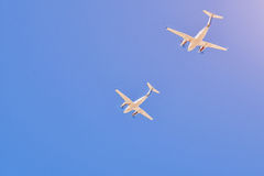 Two small aircrafts flying in a blue sky Royalty Free Stock Image