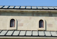 Two small arched windows under the roof Royalty Free Stock Photo