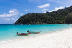 Two small boats  on the beach. Royalty Free Stock Photo