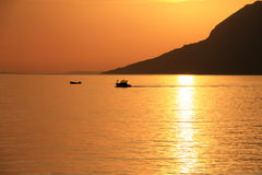 Two small boats at beautiful sunset. In Croatia Stock Photos