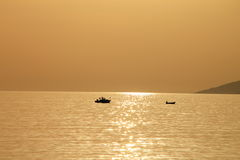 Two small boats at beautiful sunset , Croatia. Background Royalty Free Stock Images