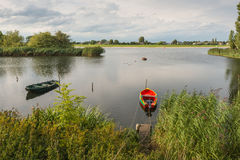 Two small boats moored near the bank of the river Royalty Free Stock Images