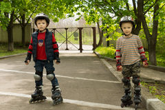 Two small boys kitted out for roller skating royalty free stock photo