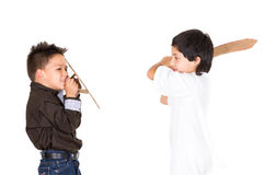 Two small boys simluating sword fight using toys Stock Photo