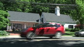 Two small buildings on main road. A view or scene from around town stock footage