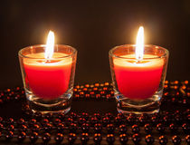 Two small burning candles Royalty Free Stock Photos