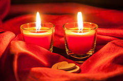 Two small burning candles and white hearts Royalty Free Stock Photos