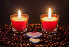 Two small burning candleson Stock Photography