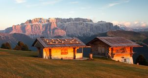 Two small cabin and Sella Gruppe or Gruppo di Sella Stock Images