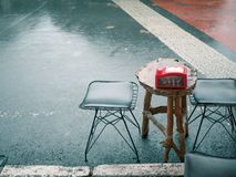 Two small chairs and little table at street food cafe stock photos