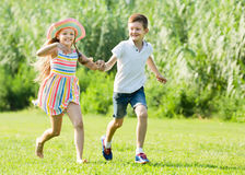 Two small children active playing and running outdoors Royalty Free Stock Photography