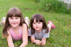 Two small children on the grass Stock Photo