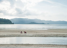 Two small children playing on the beach. In Port Barton, Philippines, Asia Stock Photo