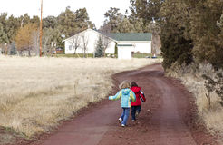 Two Small Children Running Down Rural Road Royalty Free Stock Photos