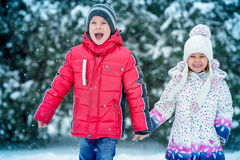 Two small children  in the snow Royalty Free Stock Photography
