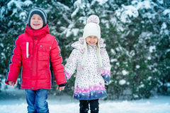 Two small children  in the snow Royalty Free Stock Image