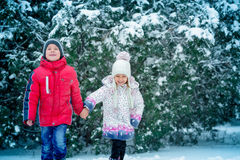 Two small children  in the snow Royalty Free Stock Photos