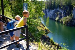 Two small childrens look through a handrail at a canyon Royalty Free Stock Image