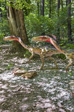 Two small dinosaurs. Close-up of two small dinosaurs running in the forest Royalty Free Stock Images