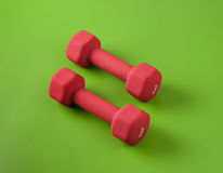 Two small dumbbells on green Stock Photos