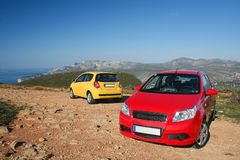 Two small family cars royalty free stock image