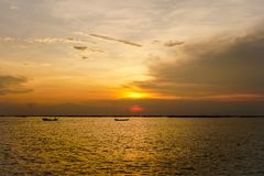 Two small fishing boat with sunset light royalty free stock photo
