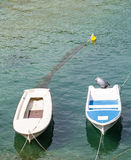 Two Small Fishing Boats in Blue Water Royalty Free Stock Photo
