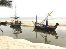 Two small fishing boats wait out for fishing. Stock Image