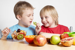 Two small friends with fruit Royalty Free Stock Photo