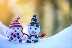 Two small funny toys baby snowman in knitted hats and scarves in royalty free stock images