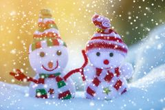 Two small funny toys baby snowman in knitted hats and scarves in royalty free stock photos
