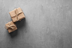 Two small gifts on a gray background Royalty Free Stock Images
