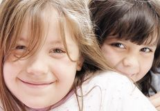 Two small girls. Two happy small girls looking at the camera and smiling Royalty Free Stock Photography