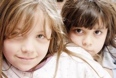 Two small girls. Looking at the camera Stock Image