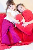 Two small girls with heart stock images
