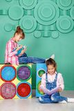 Two small girls read books in the room. The concept of childhood Stock Images