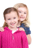 Two children smiling stock images