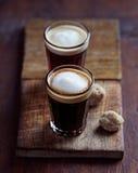 Two Small Glasses of Espresso Macchiato Stock Photos