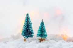 Two small green toy Christmas tree on a wooden background as  symbol of the new year with place for text, next to white Stock Image