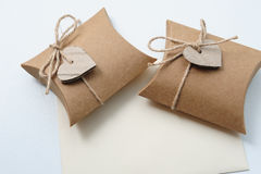 Two Small Handmade gift boxes with kraft paper with heart on white Stock Photos