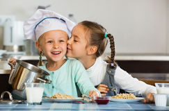 Two small  happy girls eating healthy oatmeal Royalty Free Stock Photo