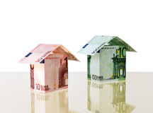 Two small houses from euro. Euro banknotes are combined in small houses (file contains clipping path for objects Stock Photo