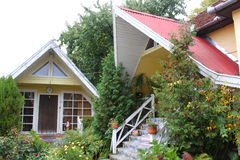 Two small houses. Two small and nice houses with garden and flowers Royalty Free Stock Images