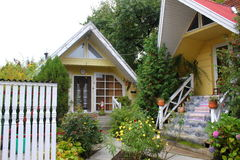 Two small houses. Two small and nice houses with garden and flowers Royalty Free Stock Photography