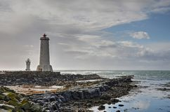 Two lighthouses at Akranes beach. Two small lighthouses on a rocky beach near Akranes, Iceland royalty free stock images