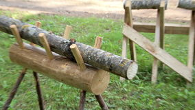 Two small logs on a wooden bench stock footage