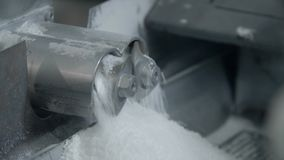 Two small mills rotating with white powder. In machine stock video footage
